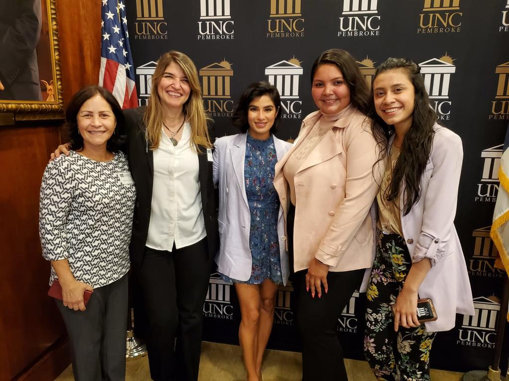 OLÉ and Acto Latino advisors Ms. Milagros López and Dr. Cecilia Lara (left), along with Acto Latino students Wendys and Joselyn (right), pose with UNCP Distinguished Speaker Diane Guerrero (center). (Photo courtesy of Milagros Lopez-Fred)