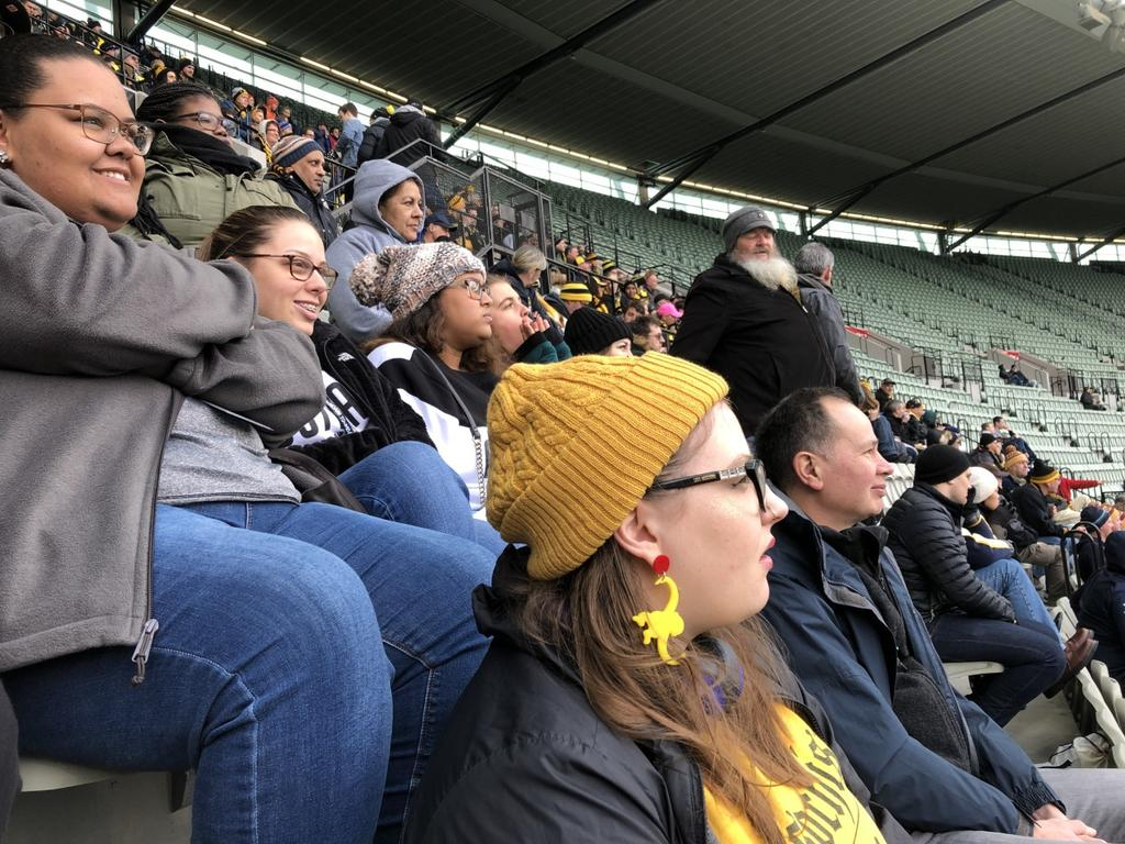 "Attending a ""footie"" game (Australian football) at the Melbourne Cricket Ground on the day before heading home."