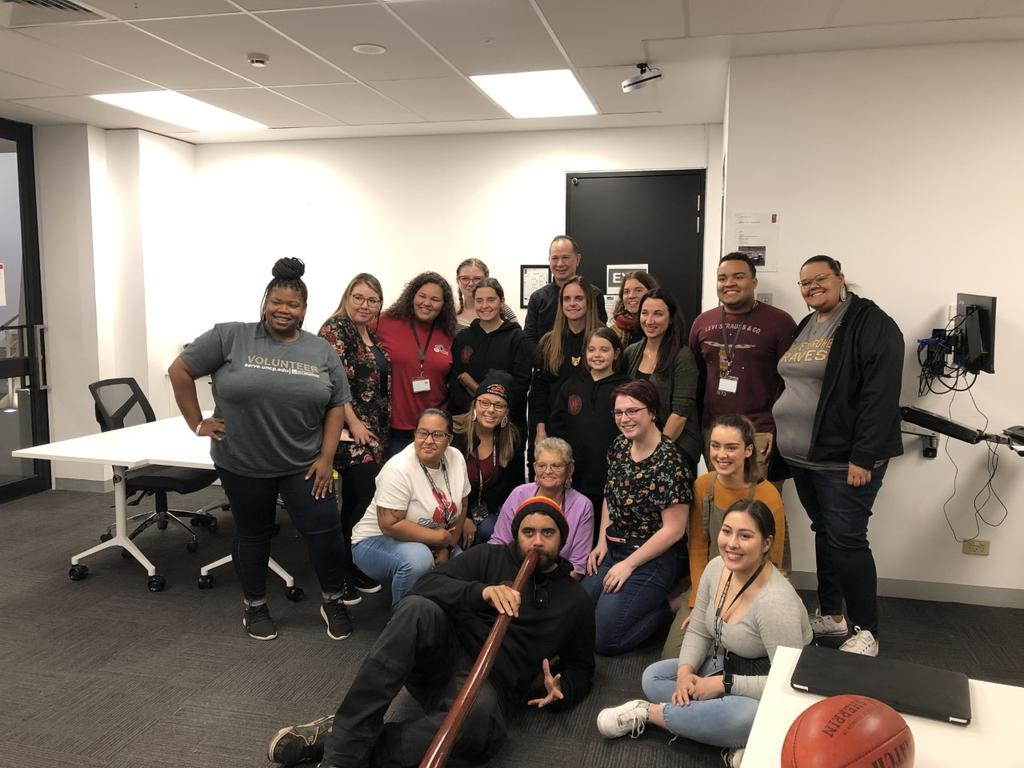 UNCP, Swinburne, and University of Saskatchewan students with Mandi Nicholson and her nephew after a Woiwurrung language and yidaki (didgeridoo) music presentation.