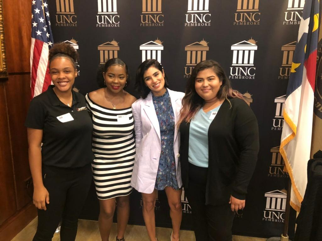 OLÉ students Simone, Namya, and Minerva, pose with UNCP Distinguished Speaker Diane Guerrero (center). (Photo courtesy of Milagros Lopez-Fred)