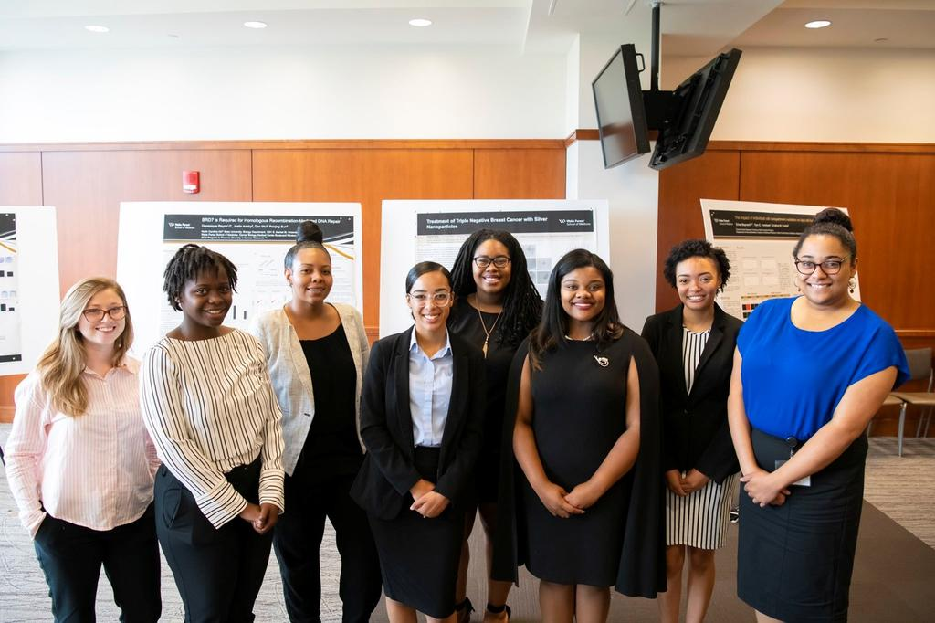 Jessica (far left) and other student interns at Wake Forest Baptist Health's Comprehensive Cancer Center