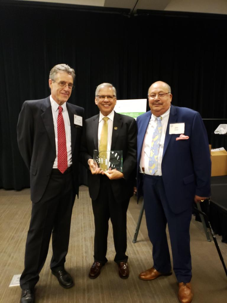 Chancellor Robin Gary Cummings (middle) with Dr. Lloyd Michener, chair of the Foundation for Health Leadership and Innovation, and Dr.  Jim Jones, former UNCP Trustee
