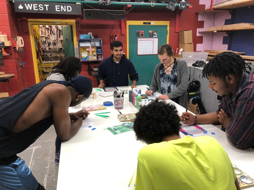 Theatre Program students learn about stain glass techniques. (Photo courtesy of David Underwood)