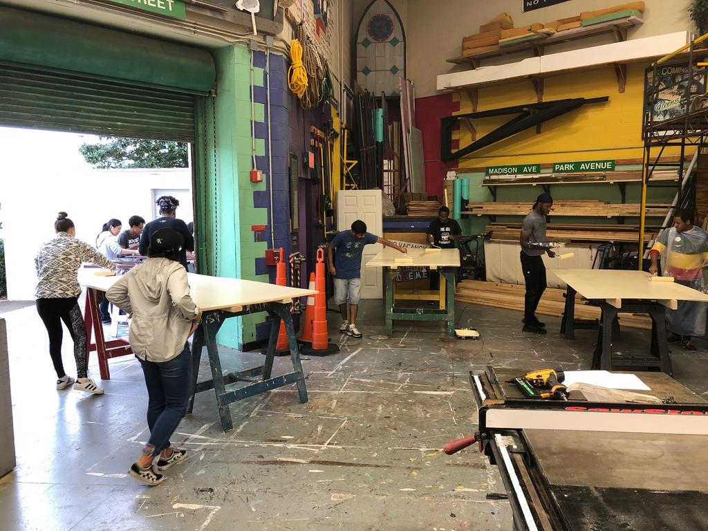 Theatre Program students paint wood for the 2019 production of Noises Off. (Photo courtesy of David Underwood)