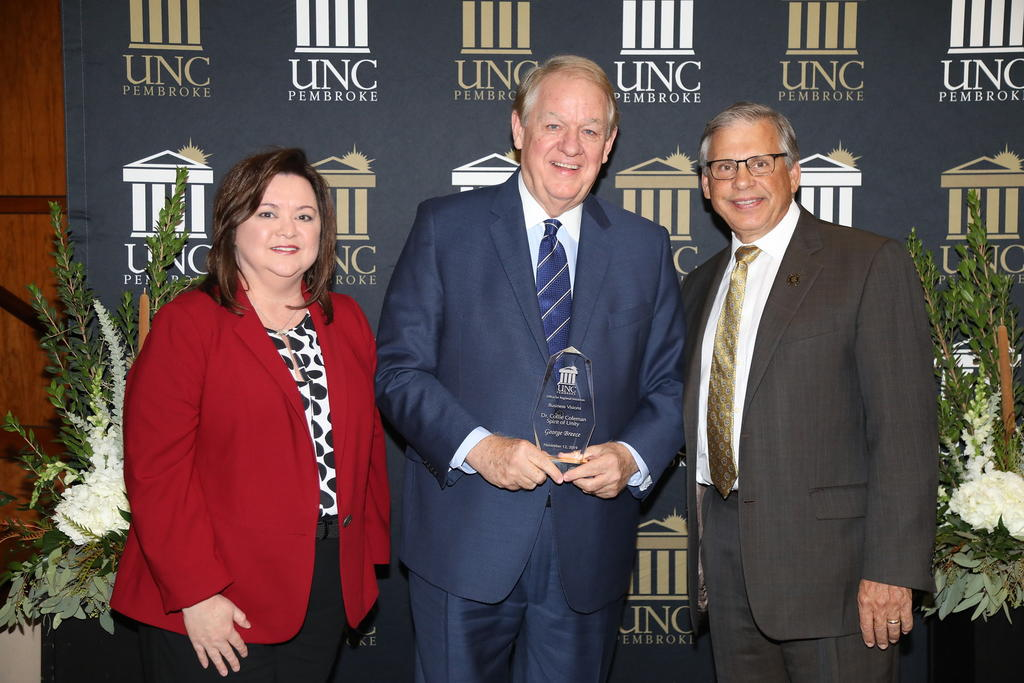 George Breece accepts the Dr. Collie Coleman Spirit of Unity Award. He is shown with his wife, Dena, and Chancellor Cummings