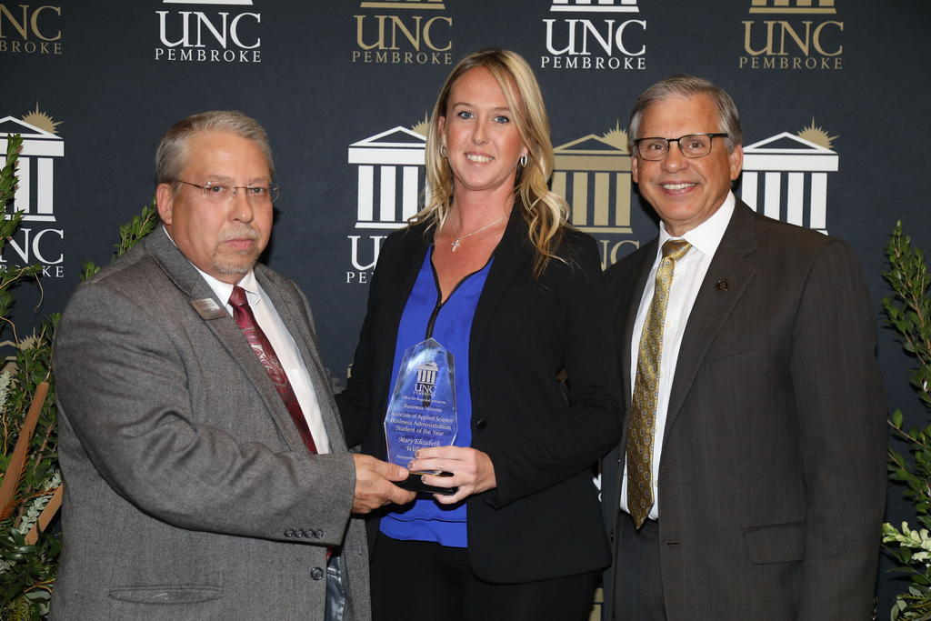 Mary Elizabeth Williford was named Robeson Community College's Business Administration Student of the Year. She is shown with George Pate and Chancellor Cummings