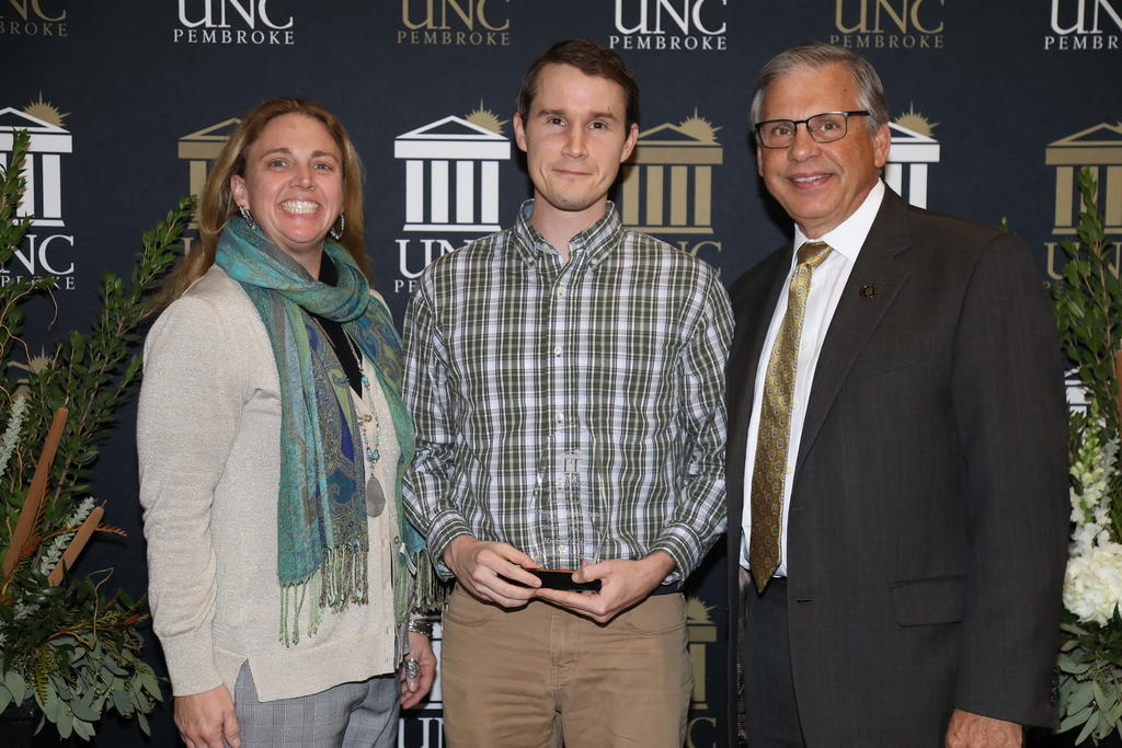 Michael Estler was named MPA Student of the Year. He is pictured with Dr. Emily Neff-Sharum and Chancellor Cummings