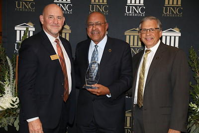 Ricky Harris was named Entrepreneur of the Year. He is shown with Thomas Hall and Chancellor Cummings