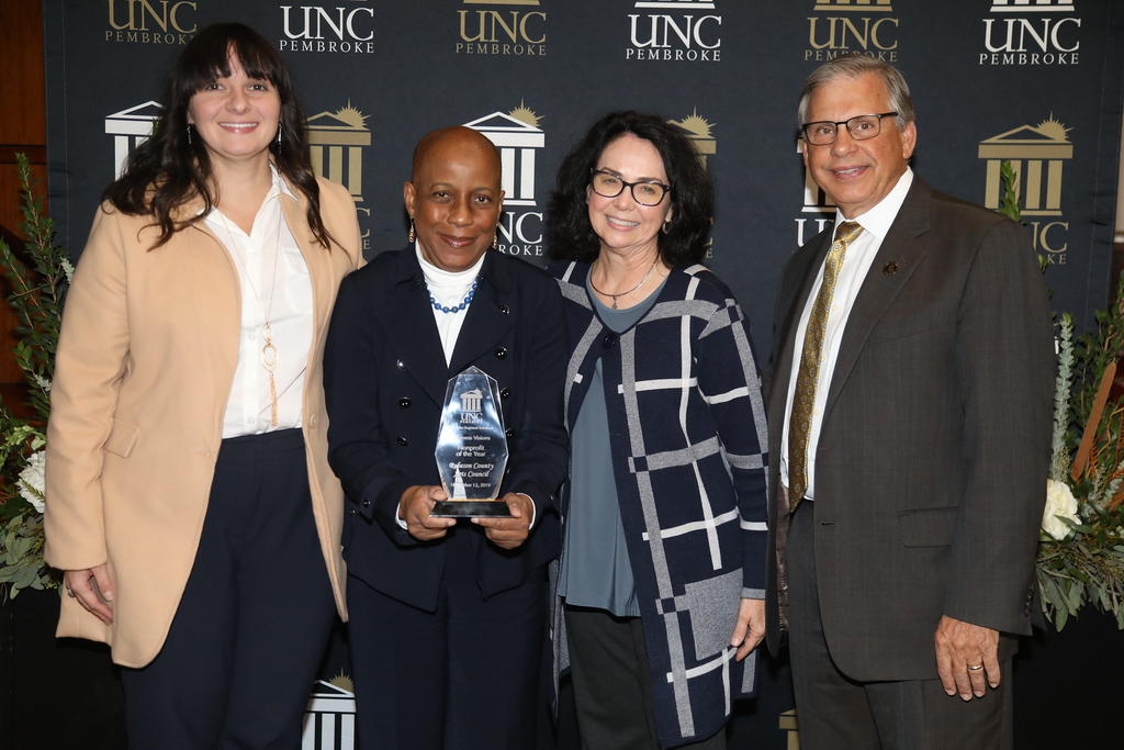 Vanessa Abernathy accepts the Nonprofit of the Year award on behalf of the Robeson County Arts Council. Also pictured are Mary Ann Ann Masters, Brittany Sandefur and Chancellor Cummings