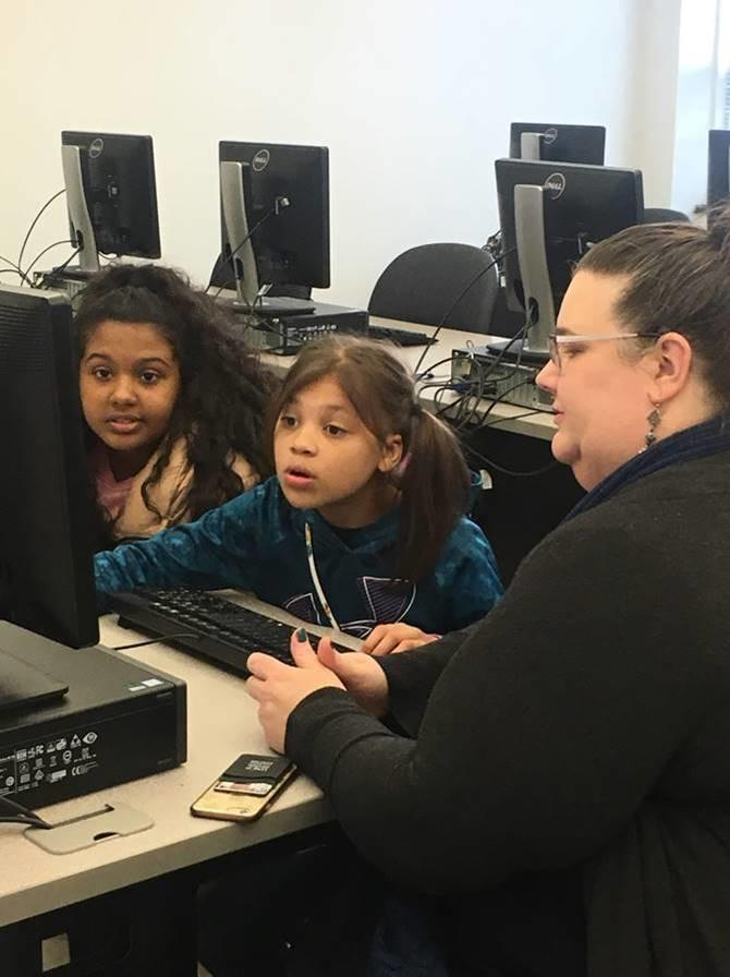 Dr. Lisa Mitchell, interim Associate Dean for the School of Education with members of the Girls Who Code program.