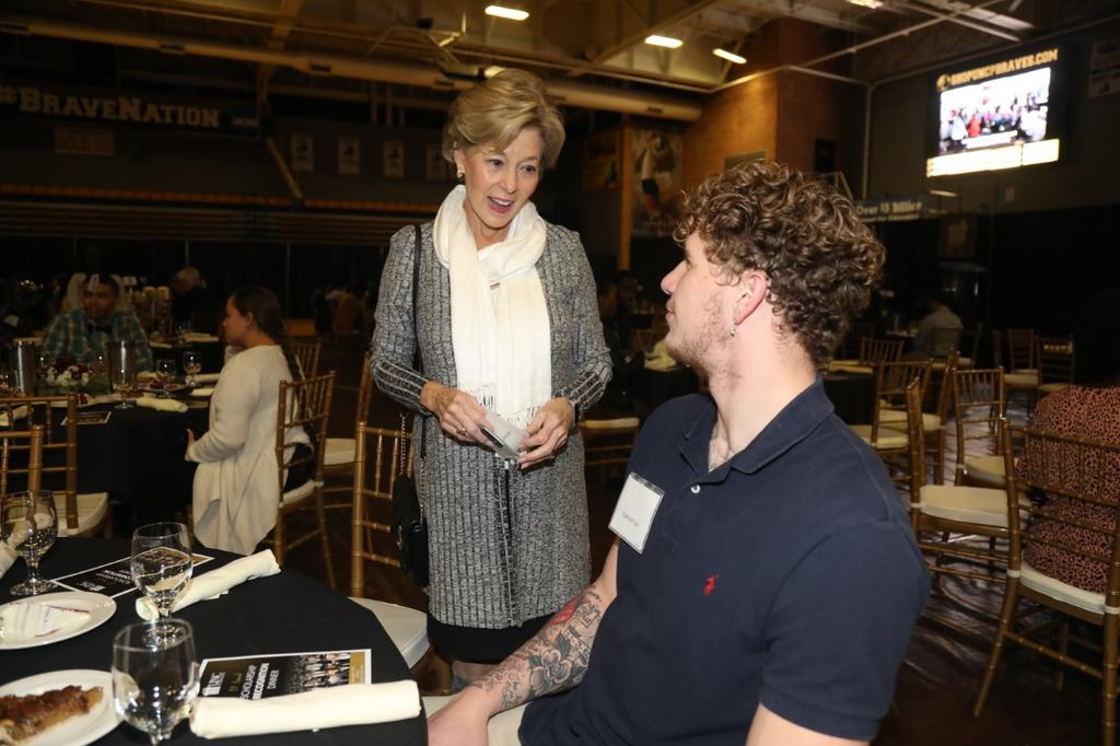 Linda Metzger chats with Spencer Levi, one of hundreds of scholarship awardees in attendance at the annual Scholarship Recognition Dinner