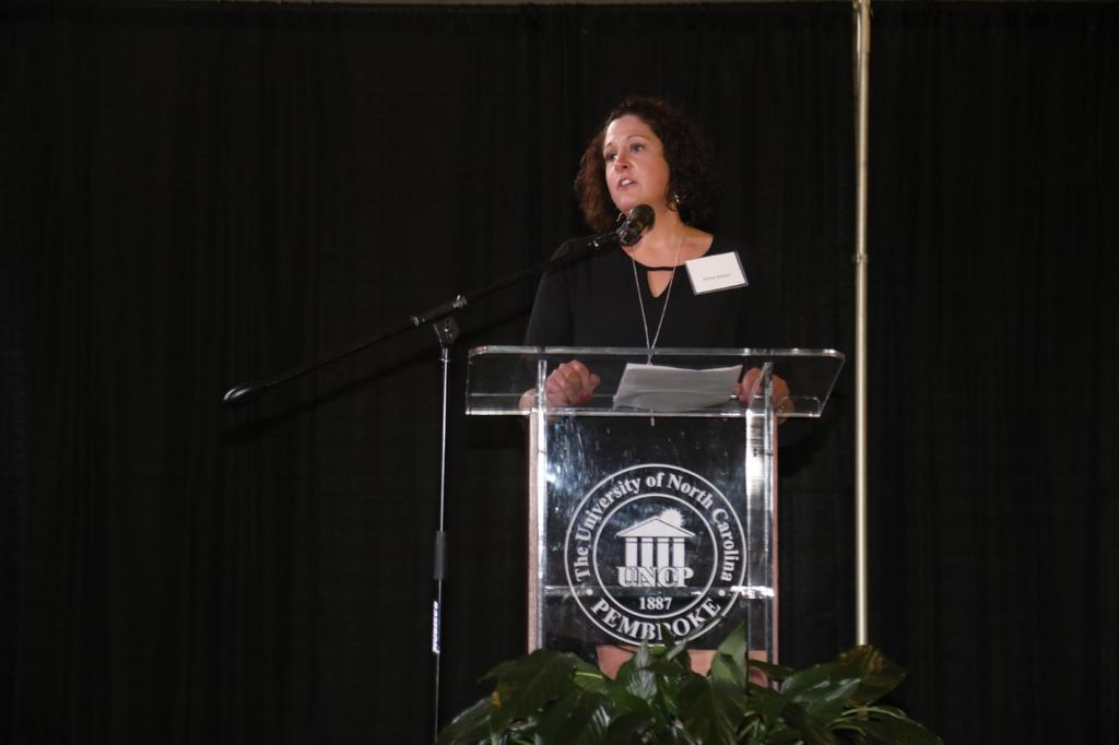 Keynote speaker Aimee Batson shares a heartfelt story about establishing a wrestling scholarship to honor her late husband and former UNCP standout Buddy Batson