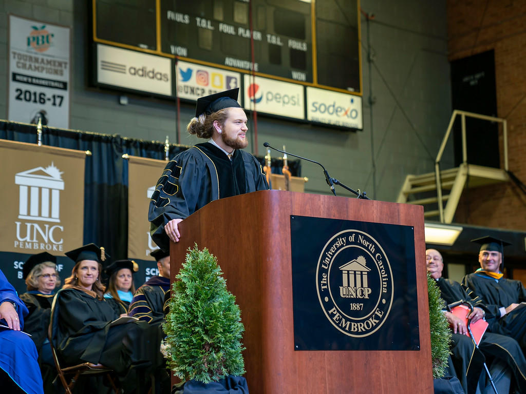 SGA Thomas Crowe-Allbritton speaks during the 2019 Winter Commencement