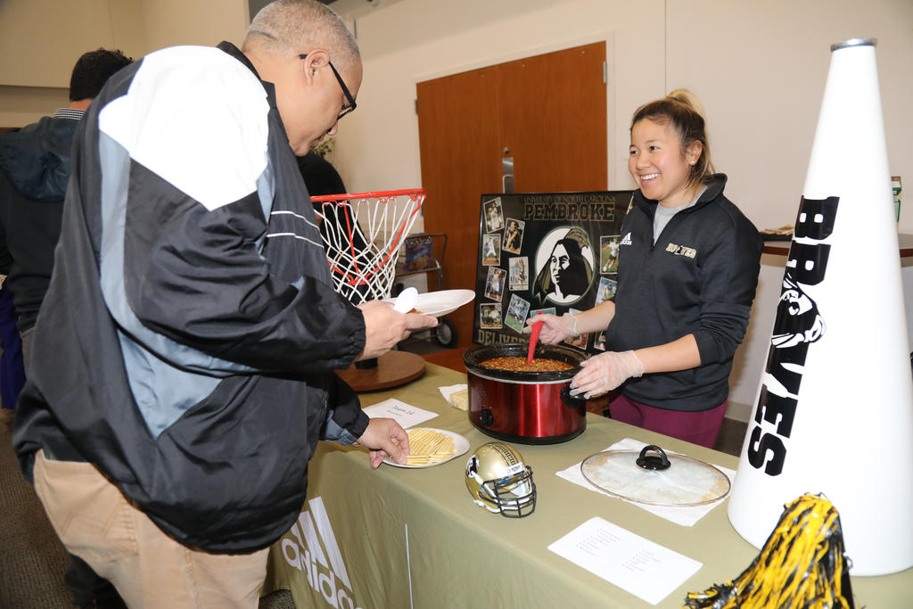 Craymon Strickland Jr. samples on the many entries at the Staff & Faculty Chili Cook-Off