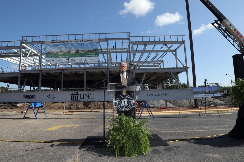 Chancellor Robin Gary Cummings speaks during a topping out ceremony for the James A. Thomas Hall