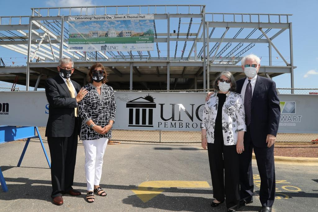Chancellor Robin Gary Cummings and wife, Rebecca, and Jim Thomas, and wife, Sally, attend the topping out ceremony for the James A. Thomas Hall