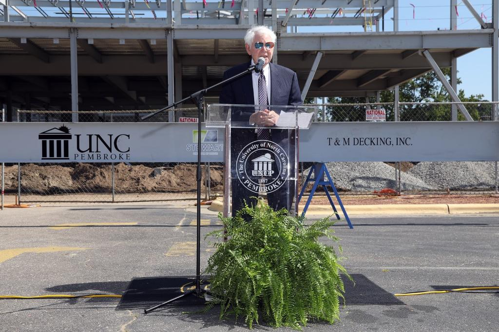 Jim Thomas speaks at the topping out ceremony for the James A. Thomas Hall on July 23, 2020