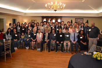The O'Neal students (seated) pose with several international students at UNCP.