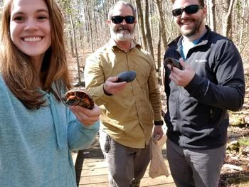 Maria Chavez, Dr. John Roe, and Kristoffer Wild find spotted turtles in the field