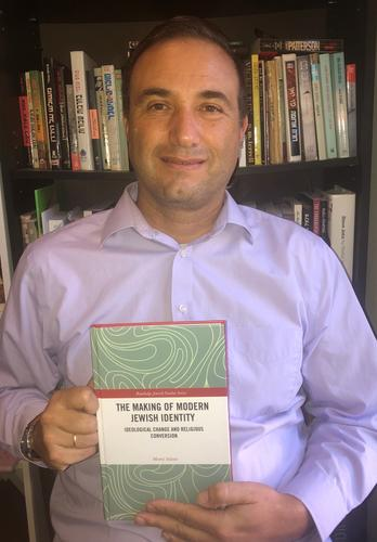 Professor Inbari with his new book.